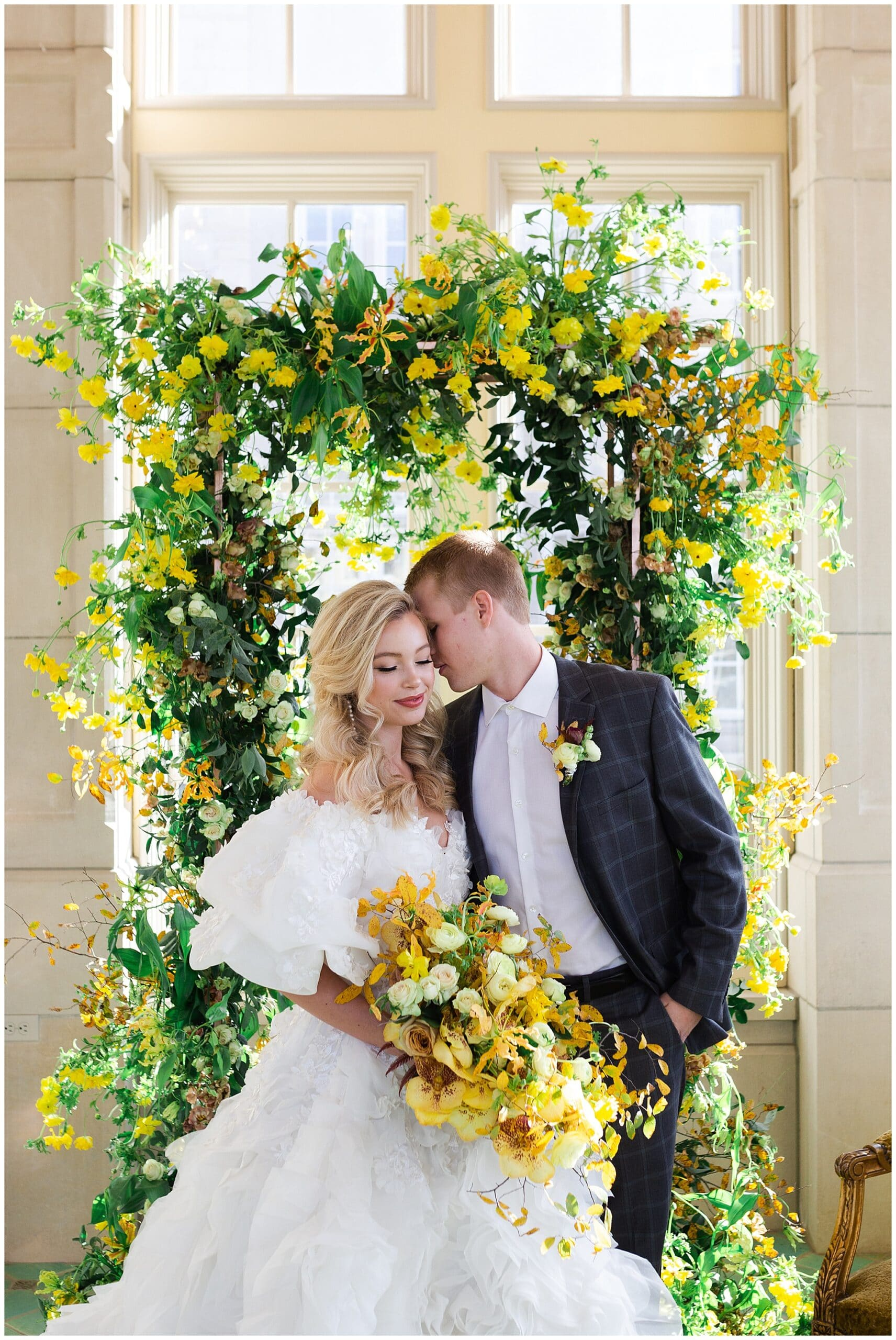 bride and groom kiss on wedding day at The Olana in Hickory Creek, Texas in a yellow themed wedding captured by Swish and Click Photography