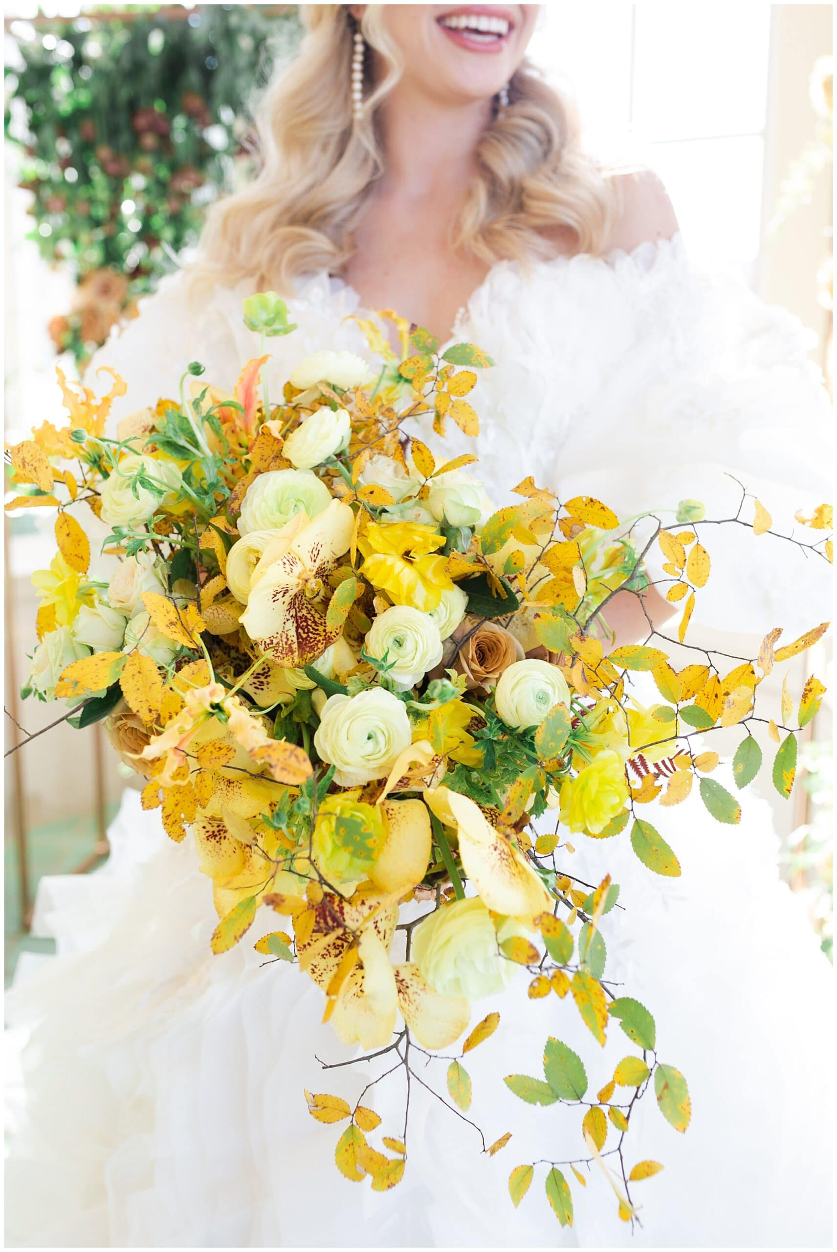 bridal bouquet on wedding day at The Olana in Hickory Creek, Texas in a yellow themed wedding captured by Swish and Click Photography