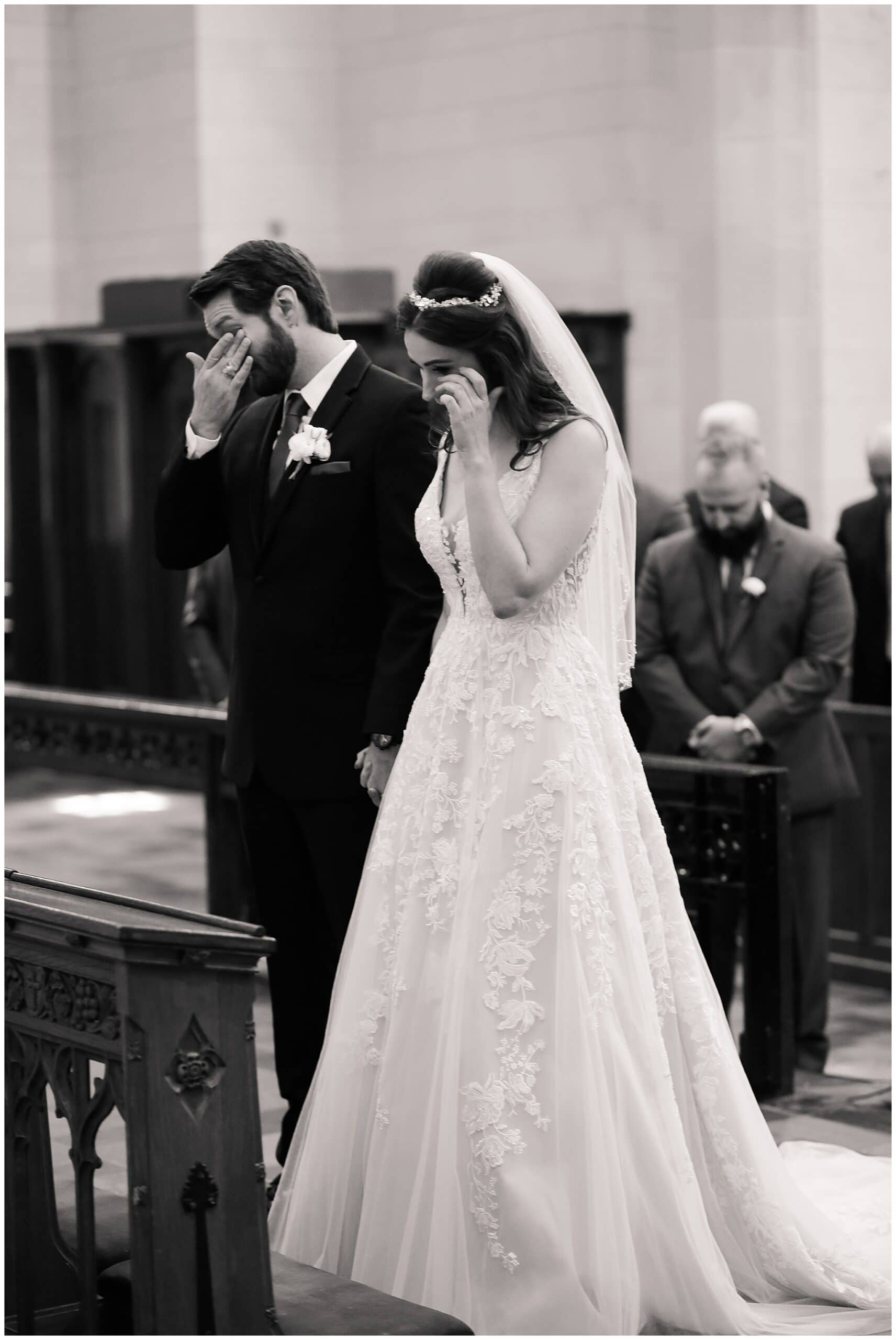 groom and bride crying during wedding ceremony at Holy Rosary Catholic Church captured by Swish and Click Photography
