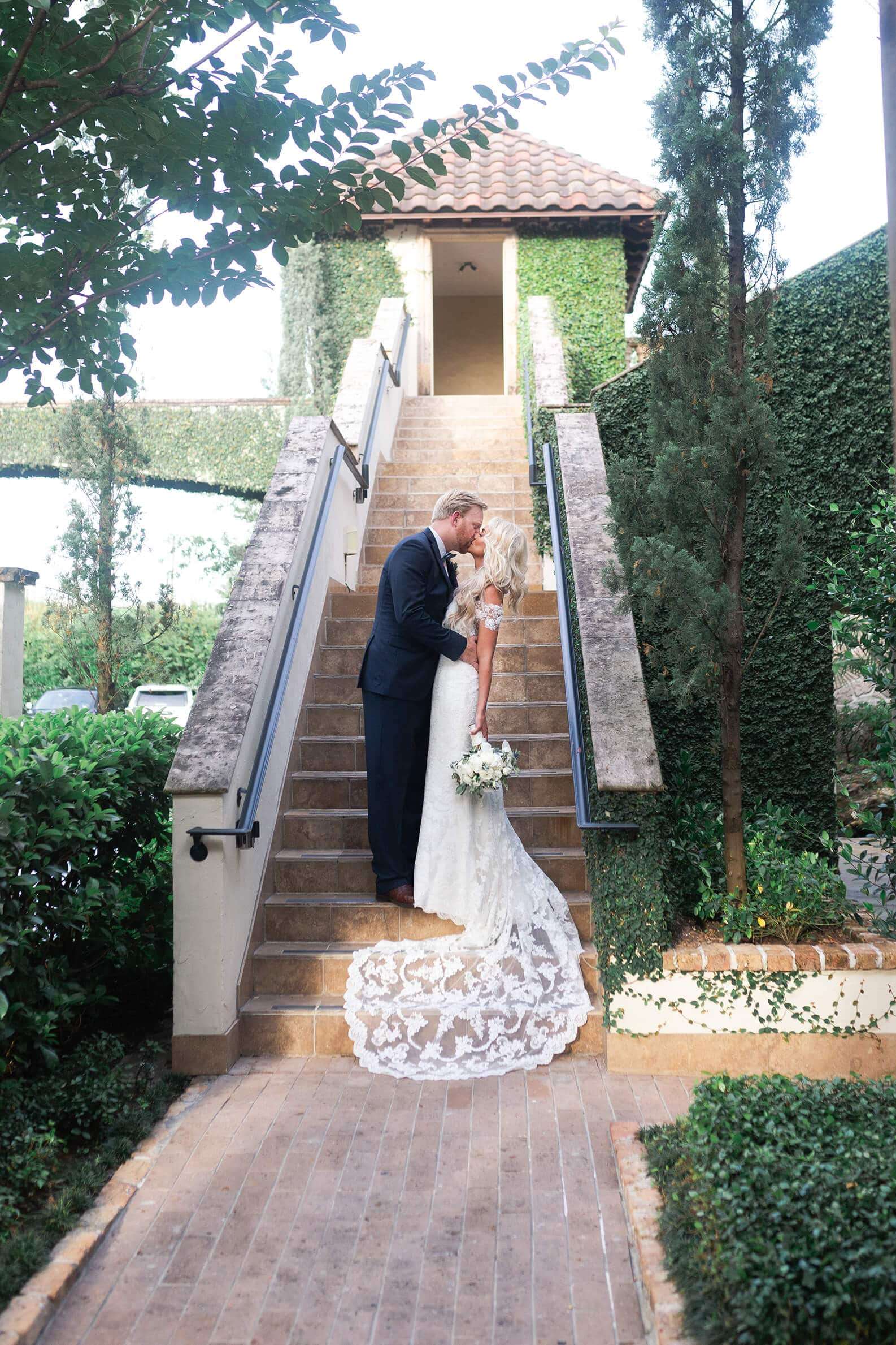 bride and groom kissing at The Bell Tower on 34th in Houston Texas by Swish and Click photography