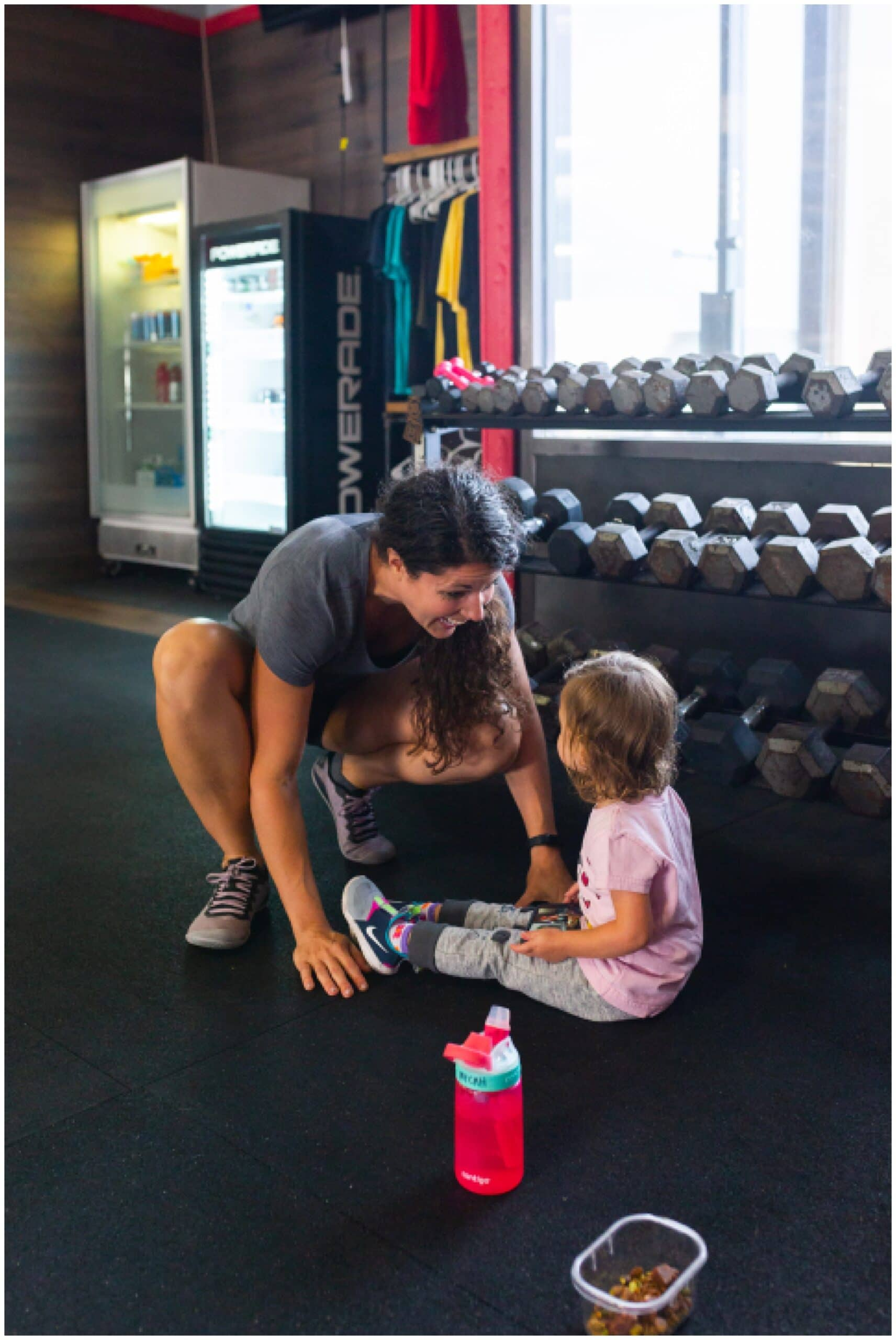 nutritionist from Focused and Fit Nutrition playing with her daughter captured by Swish and Click Photography