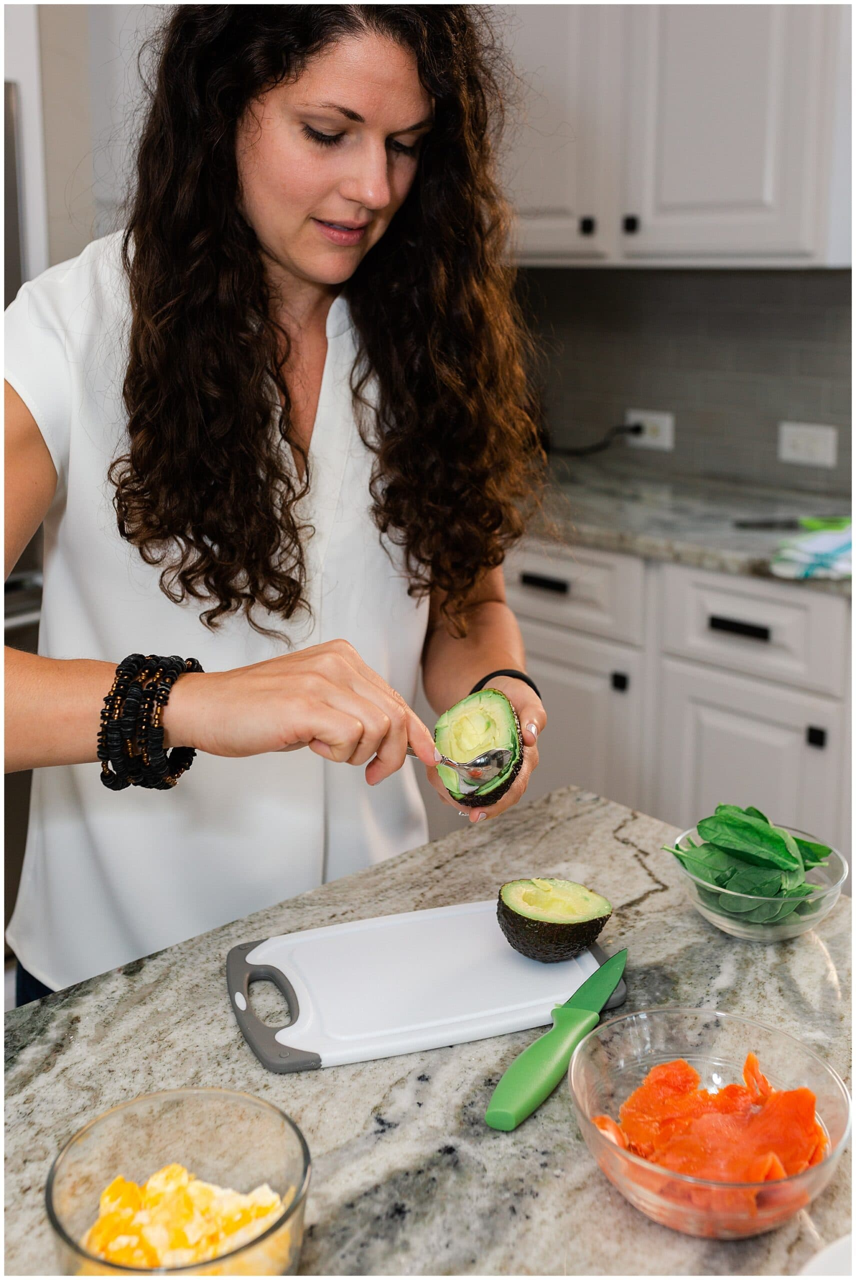 nutritionist from Focused and Fit Nutrition cutting an avocado captured by Swish and Click Photography