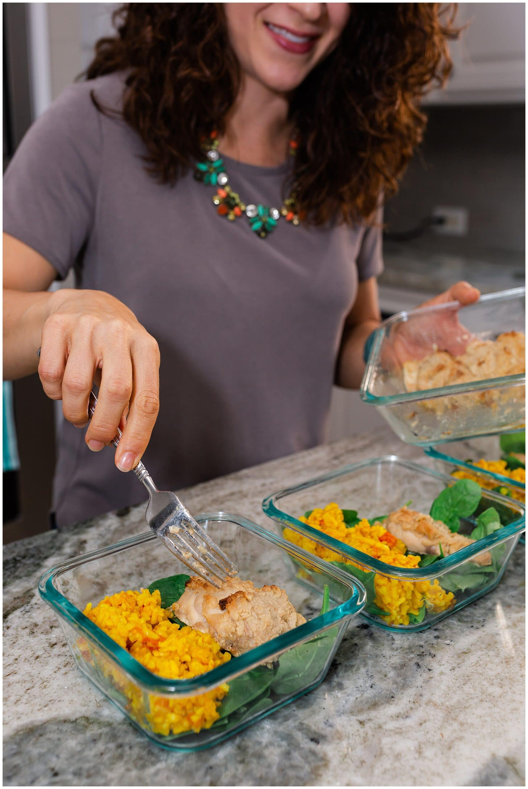 nutritionist from Focused and Fit Nutrition making a chicken dish captured by Swish and Click Photography
