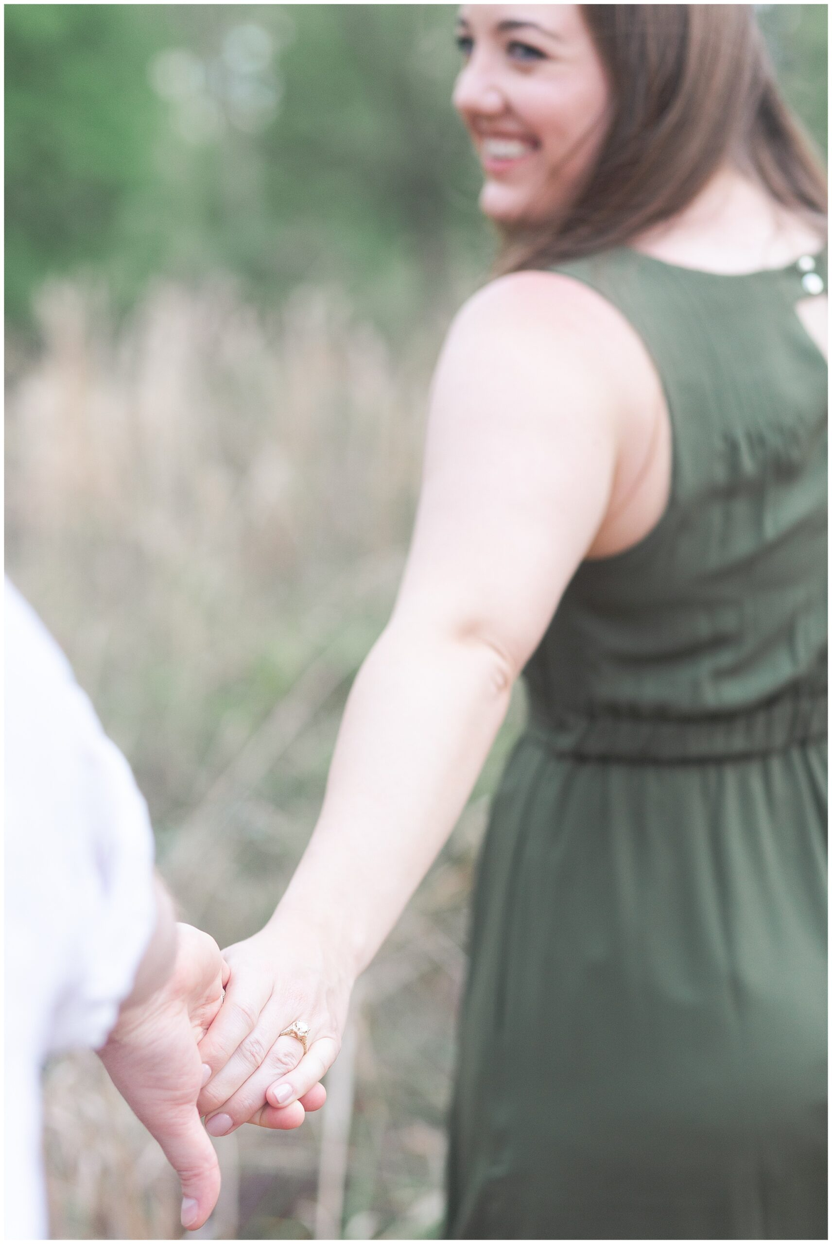 couple walking in Houston Arboretum and Nature Center during their engagement session by Swish and Click Photography