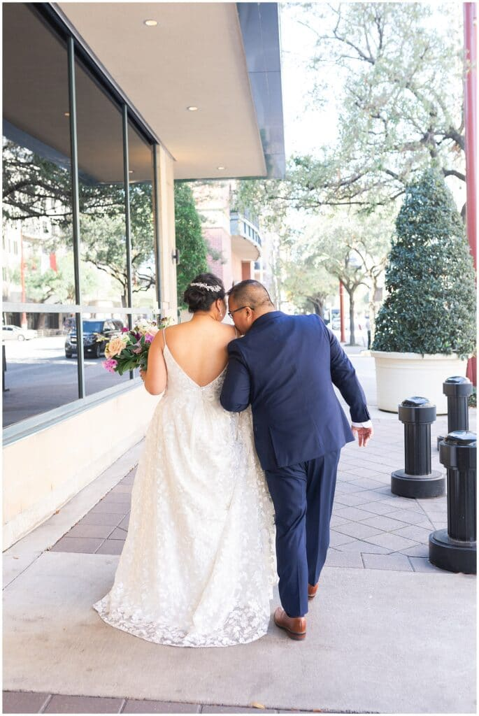 bride and groom do their first look at The Westin in downtown Houston, Texas by Swish and Click Photography