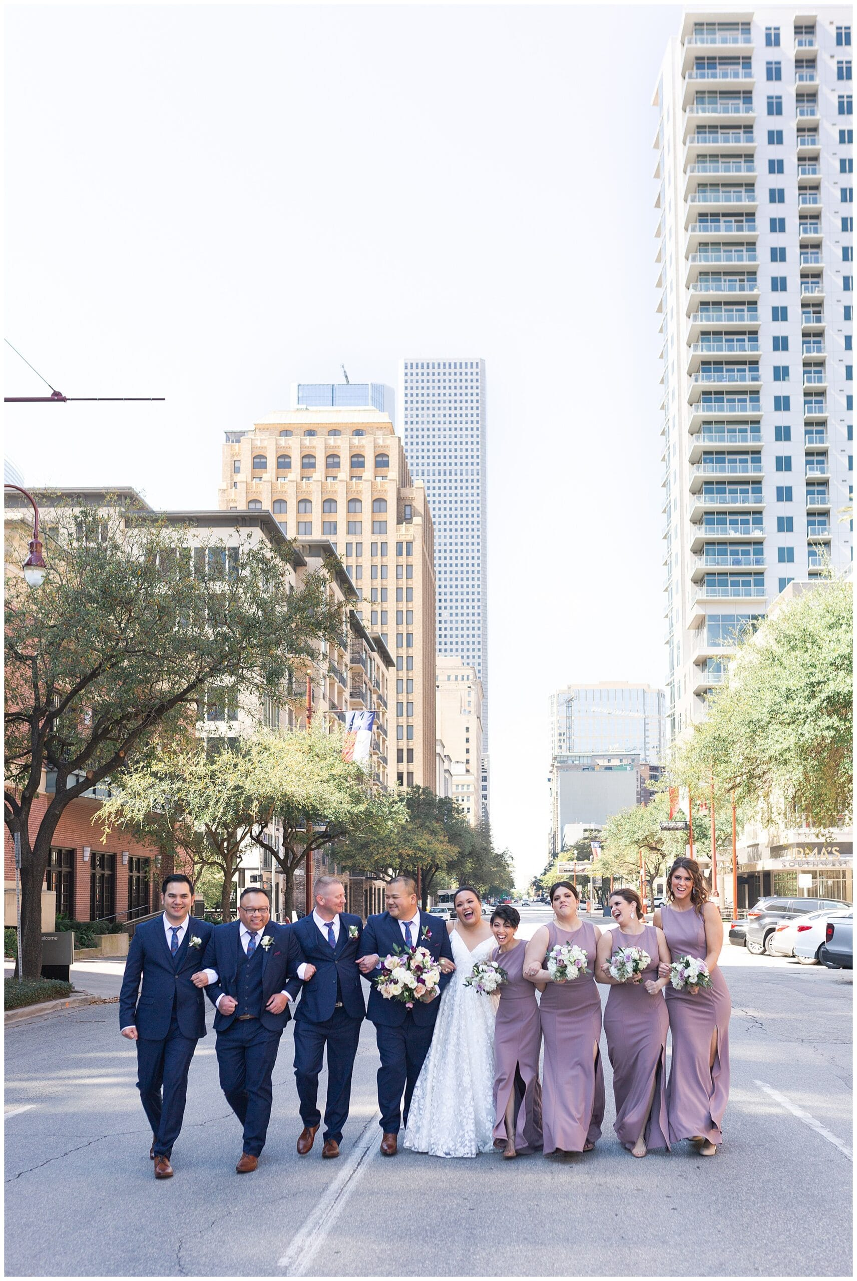 bride and groom and their wedding party at The Westin in downtown Houston, Texas by Swish and Click Photography