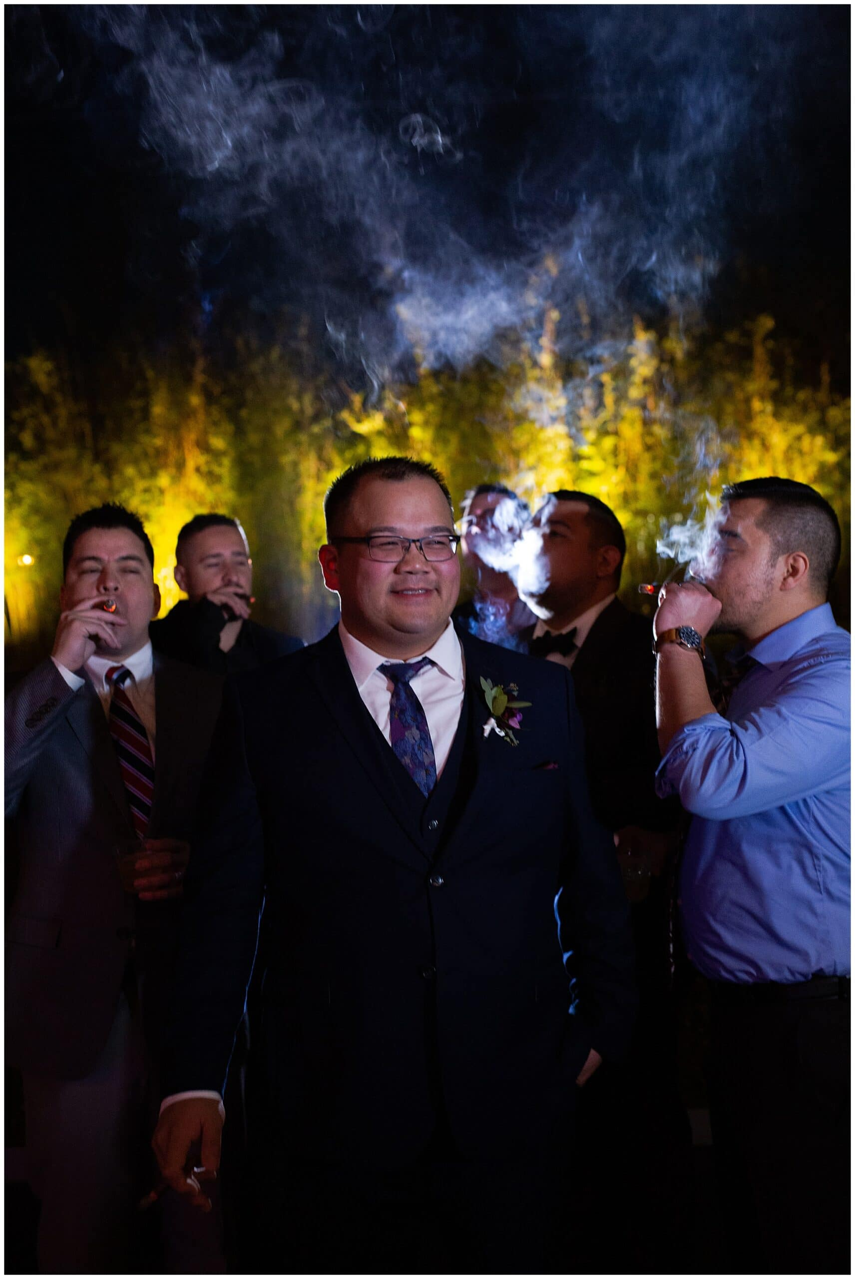 groom smoking portraits with groomsmen at the Asia Society in Houston TX by Swish and Click Photography