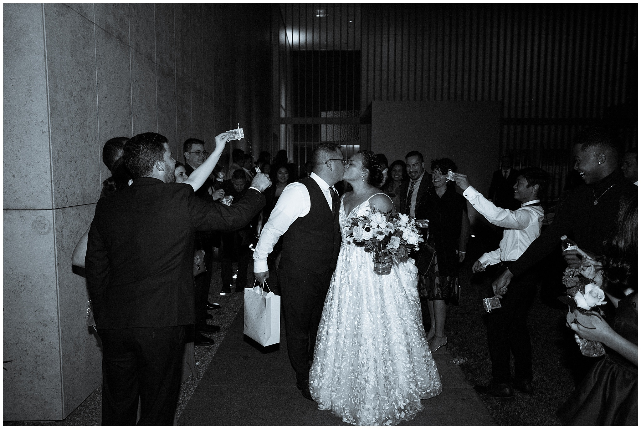 grand exit with bride and groom at the Asia Society in Houston TX by Swish and Click Photography