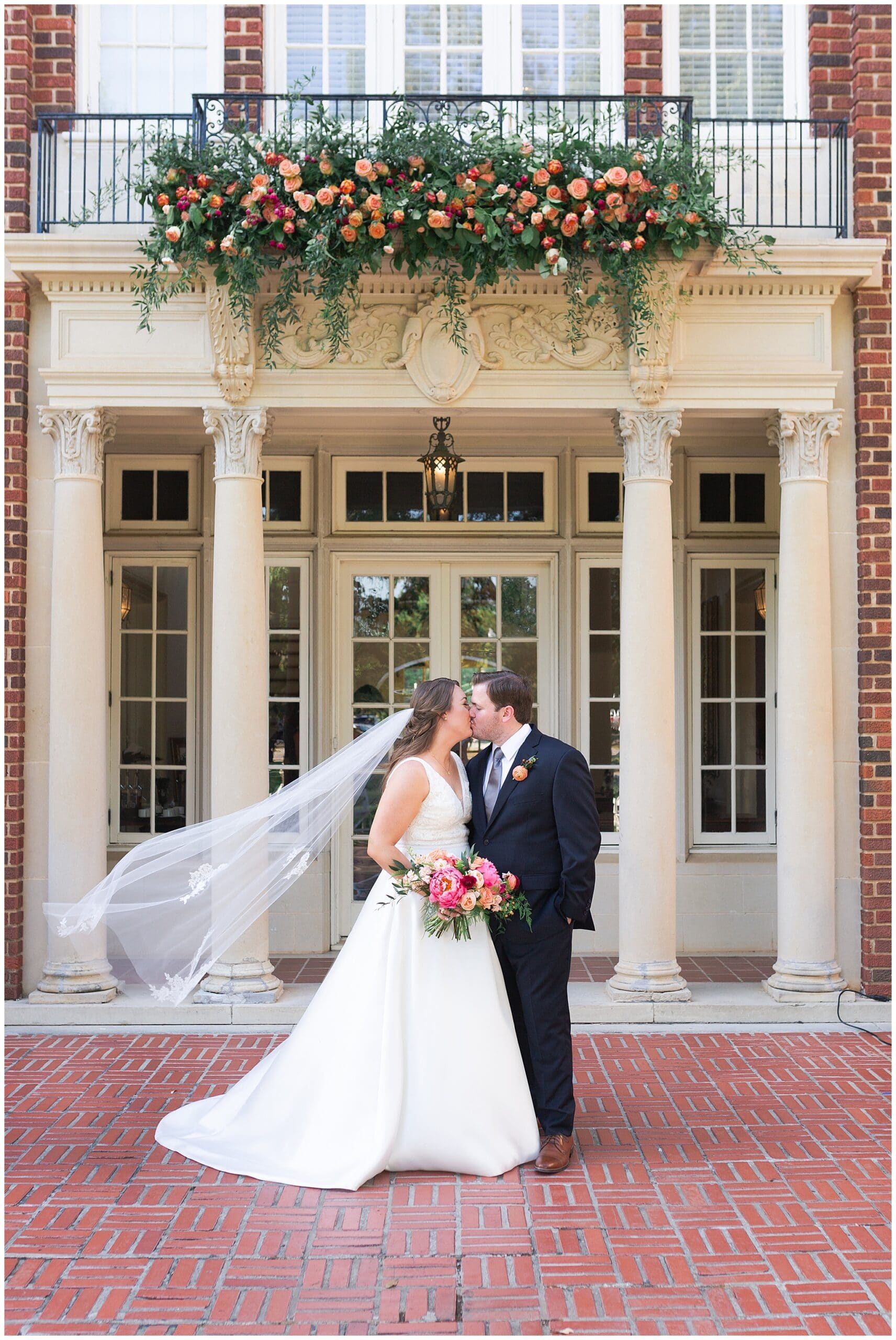 bride and groom kissing at Astin Mansion in Bryan Texas by Swish and Click Photography