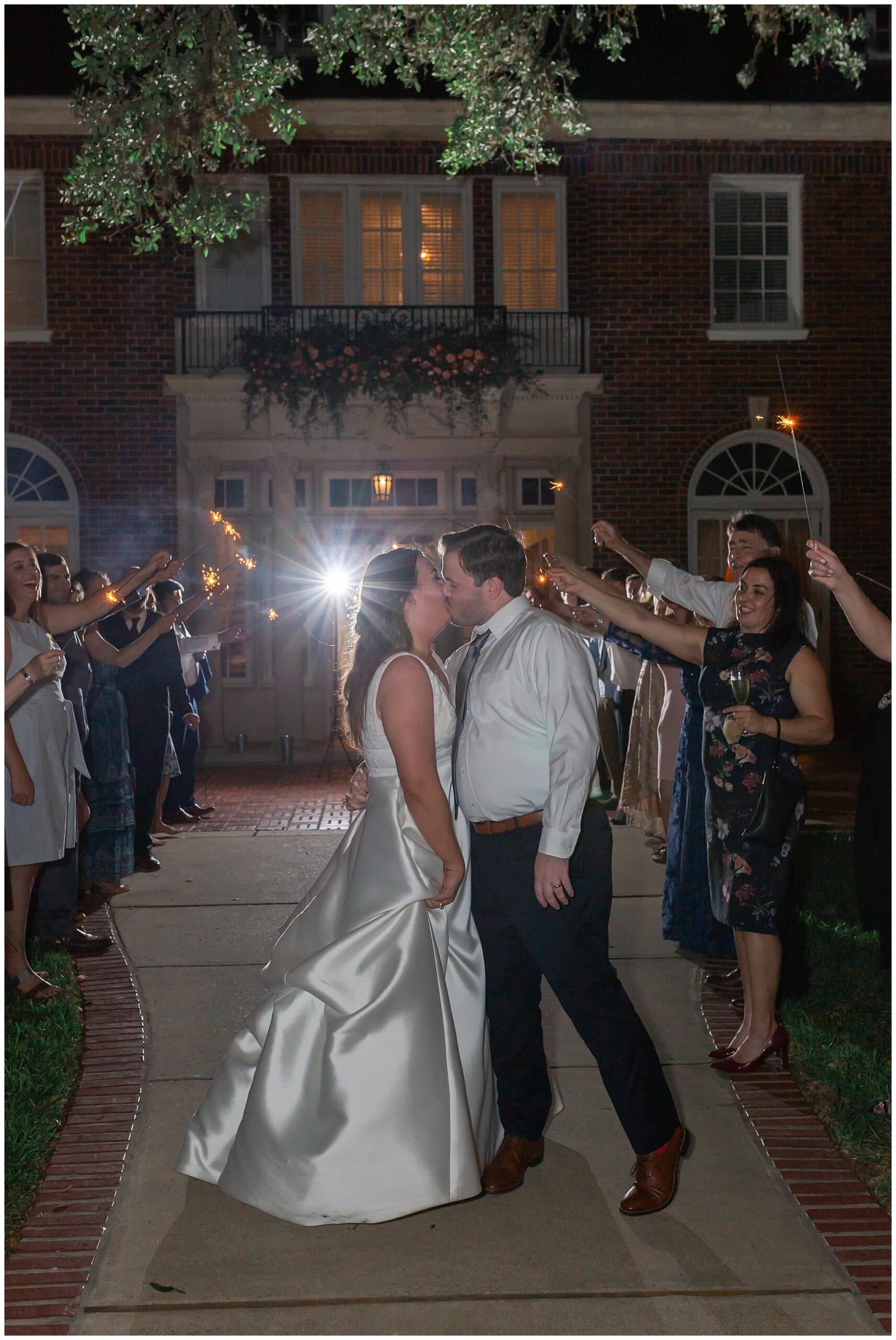 grand exit with bride and groom kissing at Astin Mansion in Bryan Texas by Swish and Click Photography