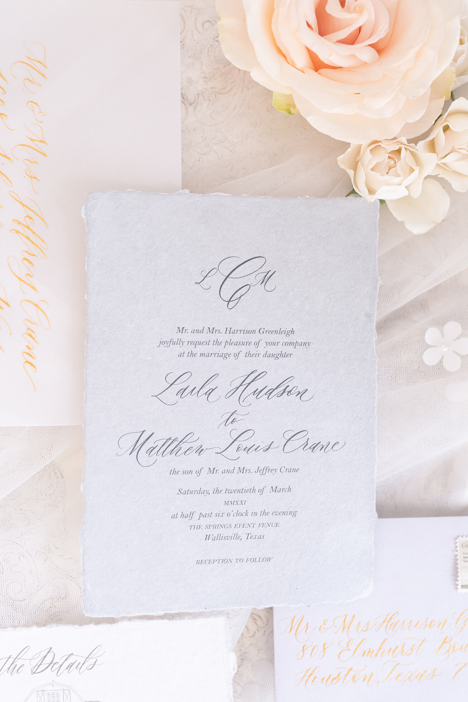 cursive wedding invitation with flowers it Wallisville Springs wedding venue in Houston Texas by Swish and Click Photography Hiring a wedding photographer
