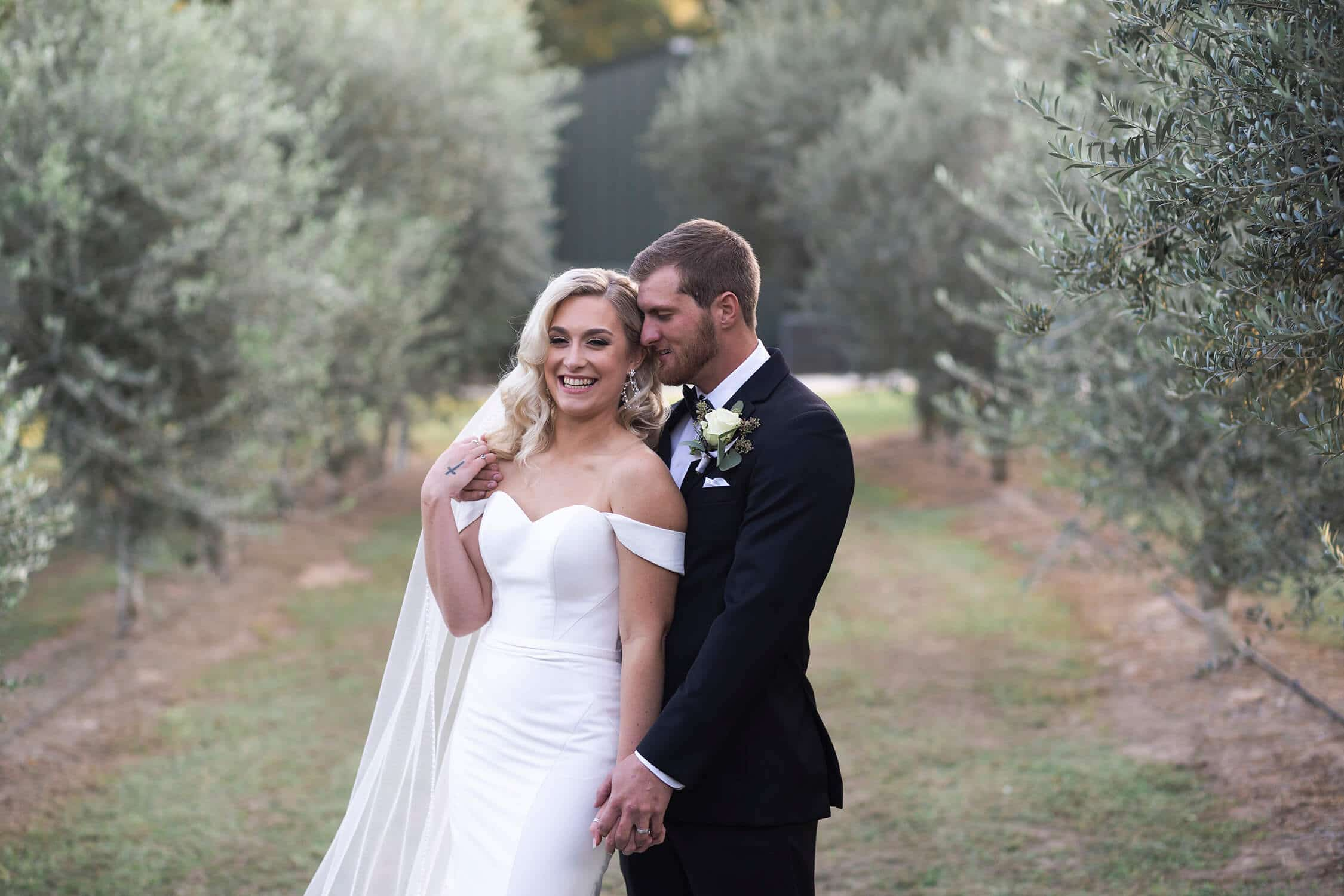 bride and groom laugh at the Annex wedding venue in Houston Texas by Swish and Click Photography