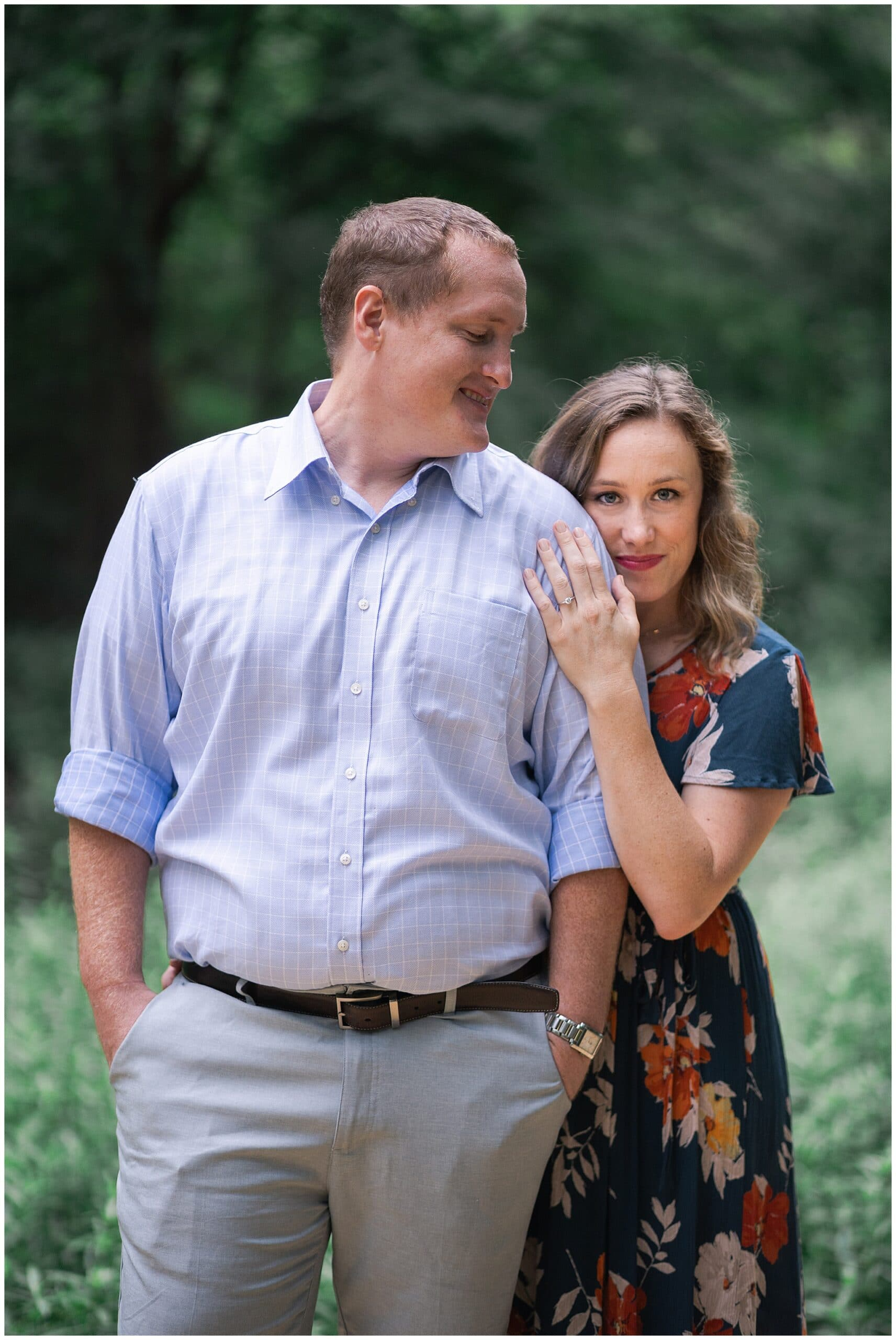 engaged couple smile at the Houston Arboretum in Houston Texas by Swish and Click Photography