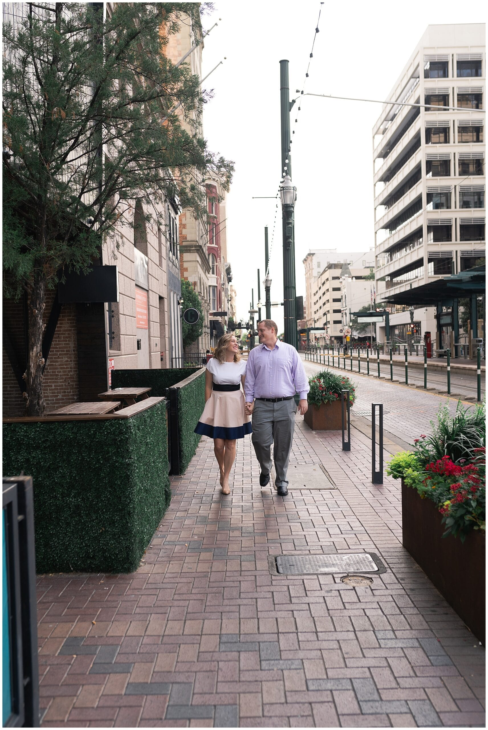 engaged couple walk outside Local Foods in downtown Houston by Swish and Click Photography