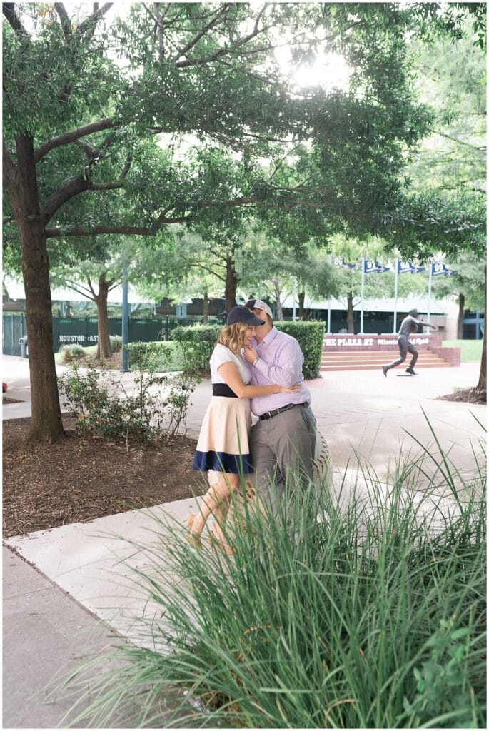 engaged couple flirt outside Astors Minute Maid Park in downtown Houston by Swish and Click Photography