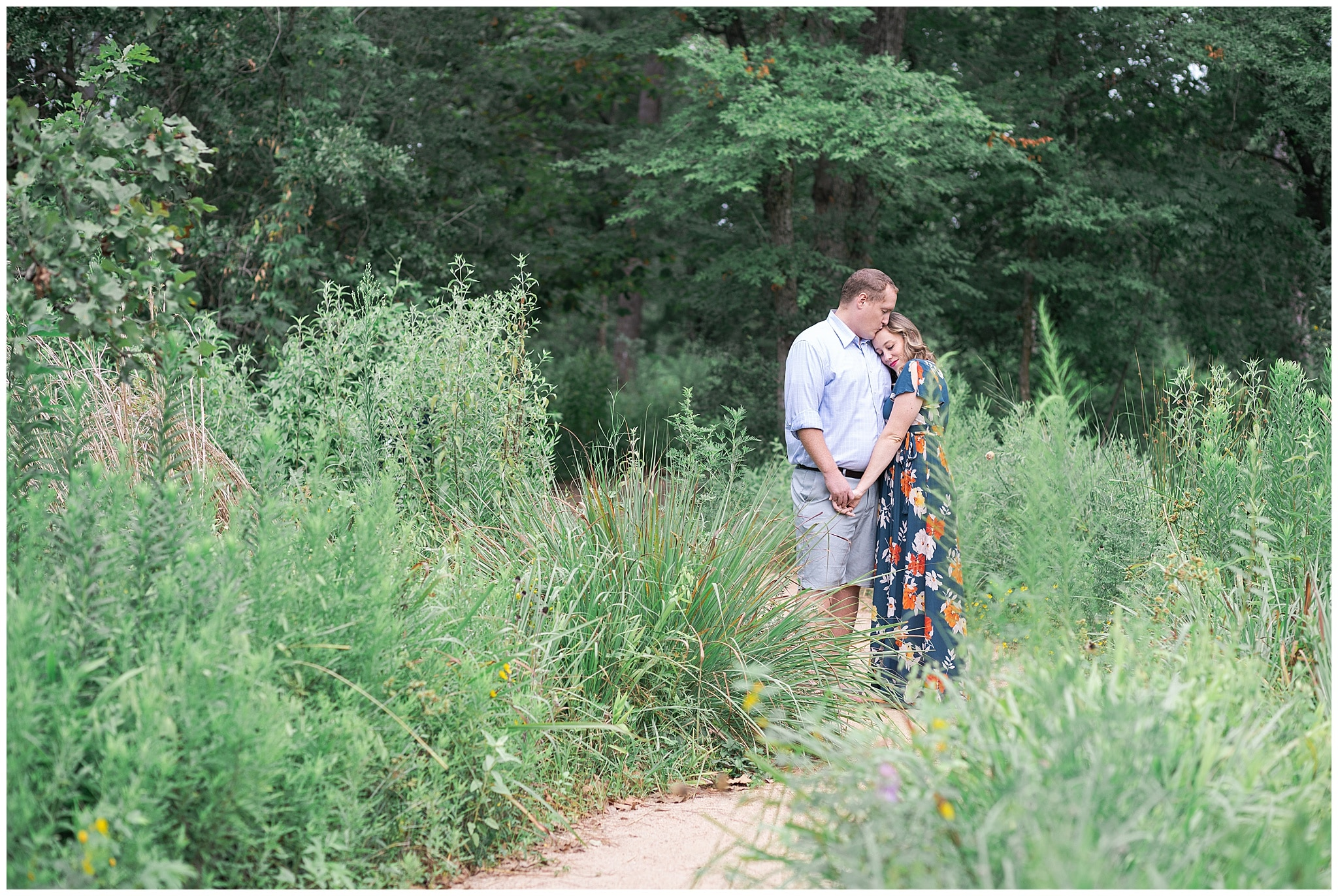 engaged couple pause at the Houston Arboretum in Houston Texas by Swish and Click Photography