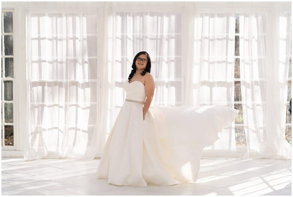 bride posing for her bridal portraits at the Oak Atelier by Swish and Click Photography