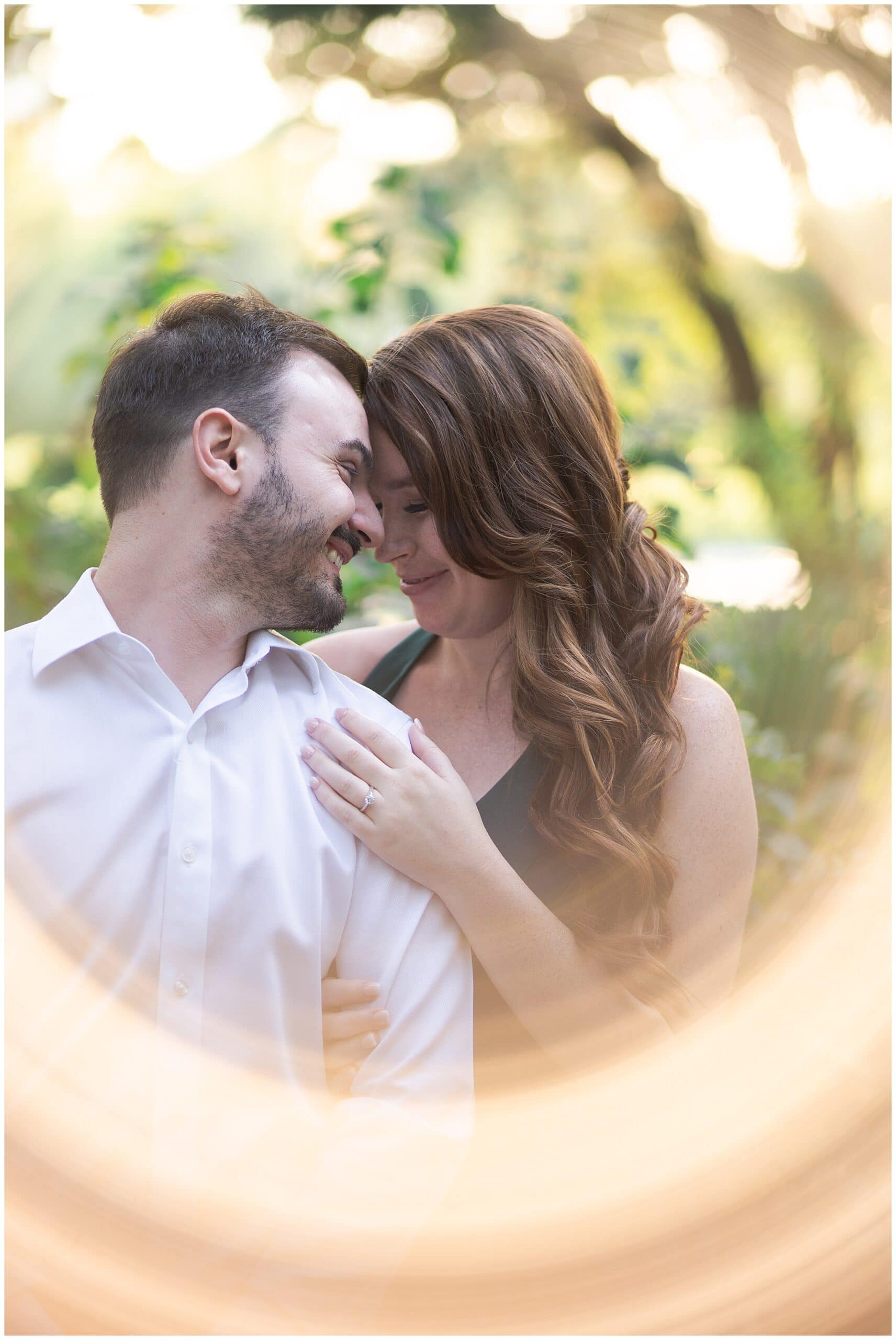 Houston engagement session at McGovern Centennial Gardens captured by Swish and Click Photography with a couple that's cuddling