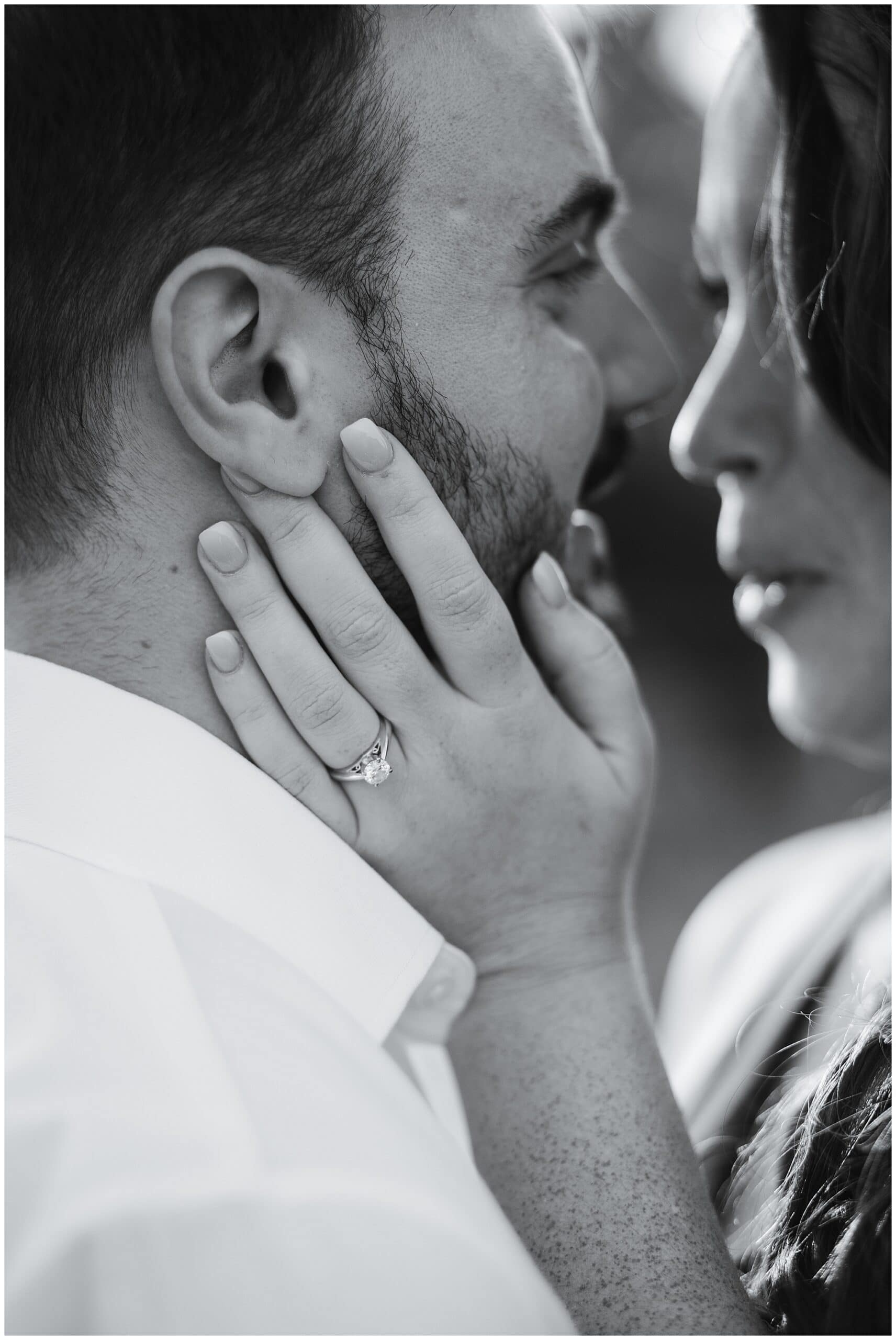 Houston engagement session captured by Swish and Click Photography with a couple that's kissing