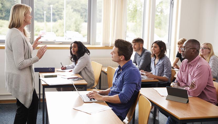 Female Tutor Teaching Class Of Mature Students