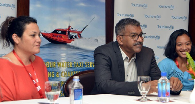 Discussing safety and security at sea, SeaFiji Director Ron Bradley, Minister for Tourism Faiyaz Siddiq Koya and Marlyn Joe during the 2015 Fijian Tourism Expo on Denarau Island