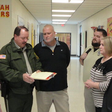 "School Officials and Deputies review results of a ""Lock Down Drill"" at Sequoyah High School"