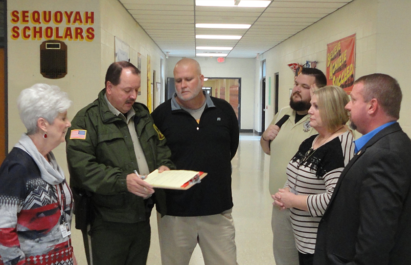 """School Officials and Deputies review results of a """"Lock Down Drill"""" at Sequoyah High School"""