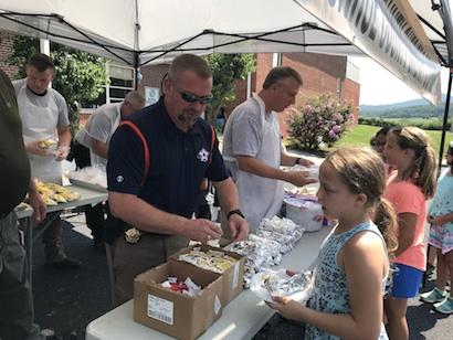 Sheriff Tommy Jones and SRO Deputy Doug Millsaps serving food at Rural Vale School.