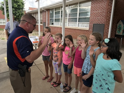 "Sheriff ""swearing in"" six new Deputies."