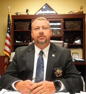 Sheriff Tommy Jones at desk