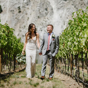 Bride and Groom in Vineyard walking