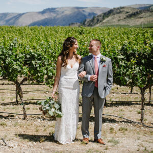 Bride and Groom in Vineyard looking at each other