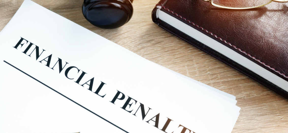 Document with title Financial penalty on a desk.