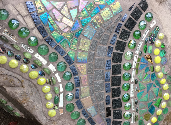 architectural mosaics ecological re-use glass mosaic how to make mosaics mosaic art mosaic sculpture Nature Mosaics utilitarian art  Dragonfly Mosaic Rock Bench Garden Seat rock-dragonfly-mosaic-bench-seat-rain-iridescent-600x439sfw