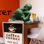 Facebook post featuring The Thinker designed for Coffee Corner by Anna Mouton.