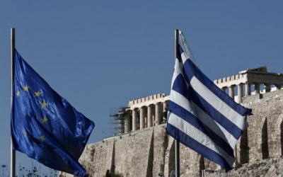 A Greek and an EU flag flutter in front of the temple of the Parthenon during the takeover ceremony of the six-month rotation of Greece's EU Presidency in Athens