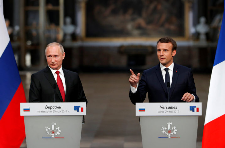 France's Macron, alongside Putin, denounces Russian media for election meddling