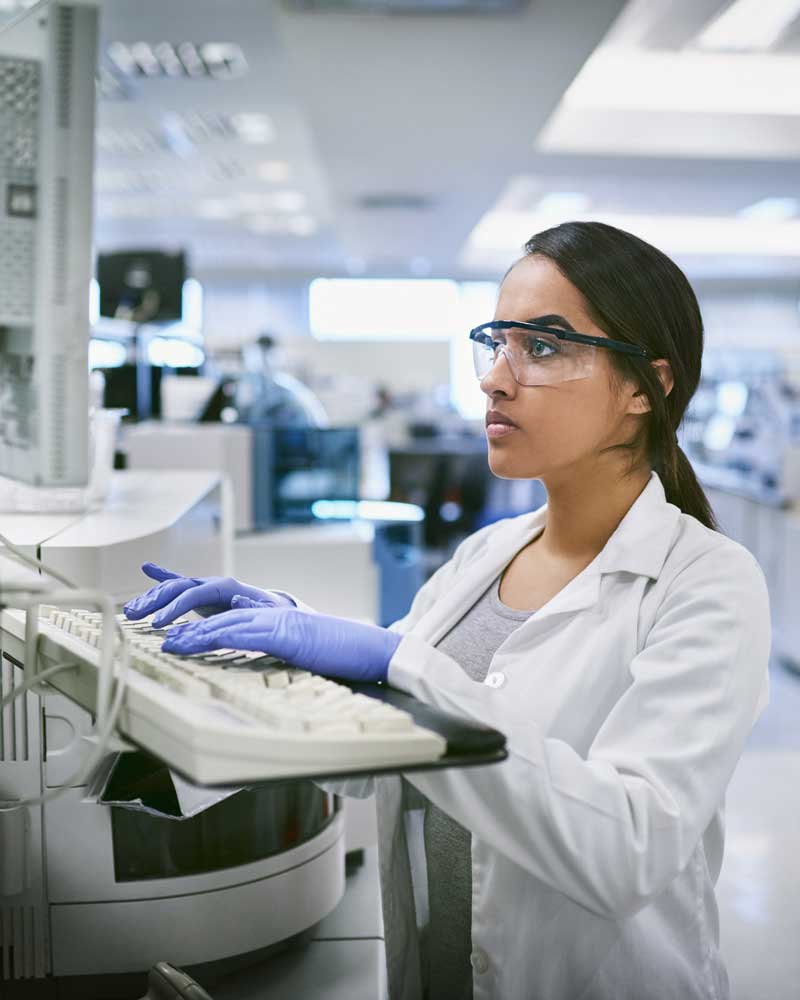 scientist in lab working on computer