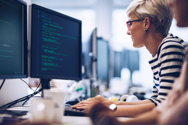 female programmer with code on screen