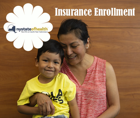 Mom holds smiling child with sign above head that reads insurance enrollment