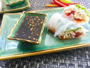 These Teriyaki Chicken Summer Rolls with Garlic Honey Soy Dipping Sauce are easy, fun, and delicious!  Teriyaki Chicken strips are layered with Rice noodles, carrots, red pepper, and basil.  All get rolled up in a light moistened rice paper.  What you get is this bite of freshness that you dip into the sweet, tangy, and salty Garlic Honey Soy Sauce.  These are a Summer delight! #chicken #summerrolls #springrolls #glutenfree