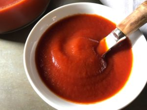This is EASY Homemade Ketchup will blow your mind and make you feel so accomplished!  It takes only MINUTES to make and has only 5 Ingredients.  Honey is the natural sweetener instead of refined sugar and – I am not kidding you – it tastes amazing!