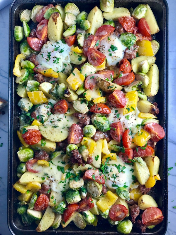 This One Pan Italian Sausage and Eggs is LOADED with flavors and textures. You get the salty Italian Sausage, sweet bell pepper, creamy potatoes, sweet and juicy tomatoes, meaty brussel sprouts, creamy eggs, and salty, nutty cheddar cheese. Best of all, the entire meal cooks on one large pan!