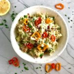 This Veggie Quinoa Salad with Lemon Dressing is a cool, refreshing, but filling and delicious salad that can stand alone or be a great side dish. It has so many fresh and flavorful vegetables including cucumber, sweet peppers, radicchio, scallions, and parsley. The dressing is a bright Creamy Lemon Dressing with Lemon, honey, mustard, and sour cream.