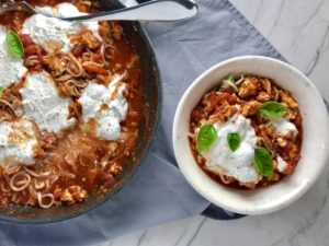 This Skillet Chicken Tomato Sauce with Ricotta is a delicious and simple one pan meal. Ground chicken is seared until it gets a super browned, flavorful crust. Then garlic, vegetable broth and tomatoes are added and cooked down into a delightful sauce that really lets the tomato shine with a meaty bite from the chicken. After pasta is mixed in, creamy Ricotta Cheese is dolloped on and fresh basil added to garnish. It's perfection!Bellissimo!