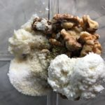 All ingredients in a blender for the Walnut Sauce: garlic, walnuts, milk-soaked bread, ricotta, parmesan. This Walnut Sauce recipe with Ricotta and Spinach is thick, rich, nutty, and creamy.  It's inspired by the traditional Italian Walnut Sauce from the North-Western Italy, Liguria Region, but my Walnut Sauce recipe adds even more decadence with creamy ricotta and more nutty parmesan cheese.