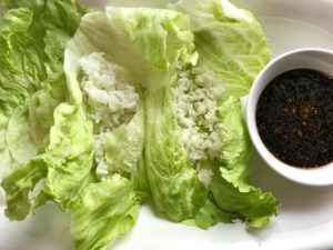 Rice in Lettuce leaves for Asian Lettuce Wraps. They are a fantastic way to use leftover Turkey or Chicken transforming it with new delicious flavors and textures. The turkey is stir fried with carrots, red pepper, and brussel sprouts in a flavorful ginger, garlic, & sesame sauce. It's layered in lettuce wraps with rice and a cool, crunchy purple cabbage sesame slaw. Serve with a Garlic Honey Soy Sauce....YUM!!!