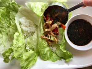Turkey stir fry and Rice in Lettuce leaves for Asian Lettuce Wraps. They are a fantastic way to use leftover Turkey or Chicken transforming it with new delicious flavors and textures. The turkey is stir fried with carrots, red pepper, and brussel sprouts in a flavorful ginger, garlic, & sesame sauce. It's layered in lettuce wraps with rice and a cool, crunchy purple cabbage sesame slaw. Serve with a Garlic Honey Soy Sauce....YUM!!!