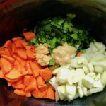 Carrots, onion, parsley, garlic, dijon in crockpot for the Slow Cooker Beef Stew over Noodles recipe. It's comfort food full of flavor and texture with carrots, onion, garlic, thyme, beef, and more. Now, try pouring that salty, chunky, saucy goodness over noodles...yup, even more amazing! #beefstew #crockpot #slowcooker #easydinners #dinnerrecipes