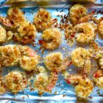 Baked Coconut Shrimp on pan. Crunchy and utterly irresistible, this 30-Minute Baked Coconut Shrimp recipe is one that you have got to try!  They are baked, not fried, so they are EASY to cook and HEALTHIER for you too!